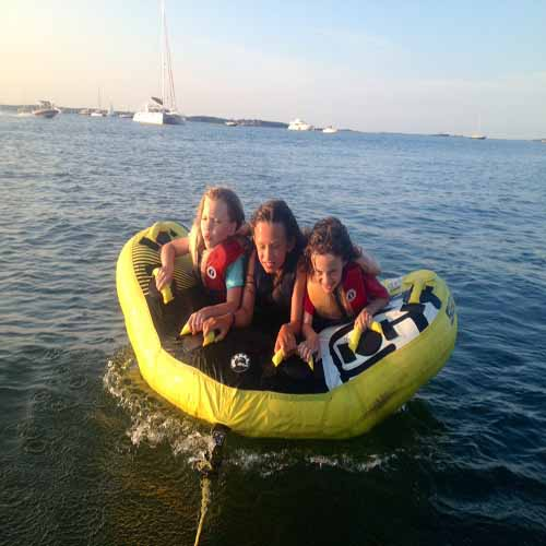 Kids tubing adventure aboard sailing charter Hamtons and Biscayne Bay Florida
